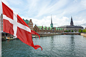 Flag of Denmark on the background of The Historic Old Town of Copenhagen.