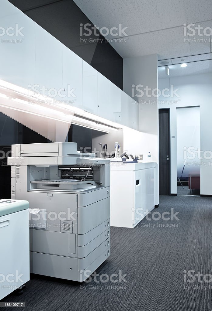 copier in an office floor stock photo