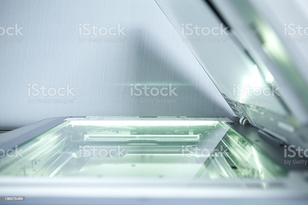 copier with a bright light inside copier with a bright light inside Flat Bed Scanner Stock Photo