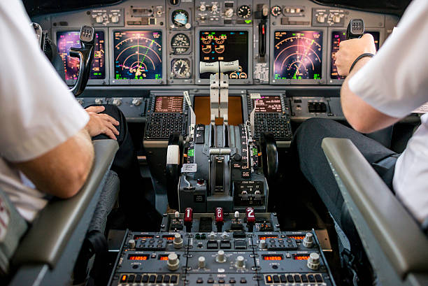 co-pilot flying an aircraft - cockpit stock photos and pictures
