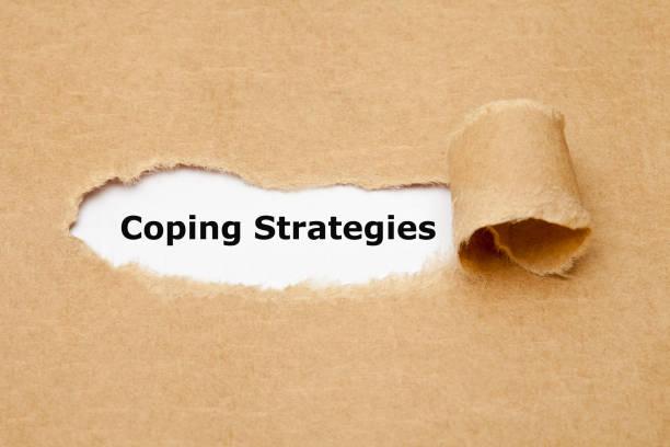 coping strategies torn paper concept - sopravvivenza foto e immagini stock