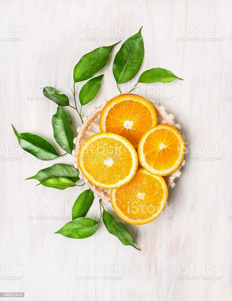 Copmosing with sliced oranges and  leaves , top view stock photo