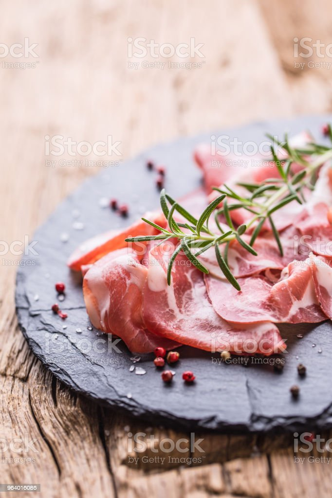 Coppa di Parma ham on slate board with rosemary salt and pepper - Royalty-free Appetizer Stock Photo