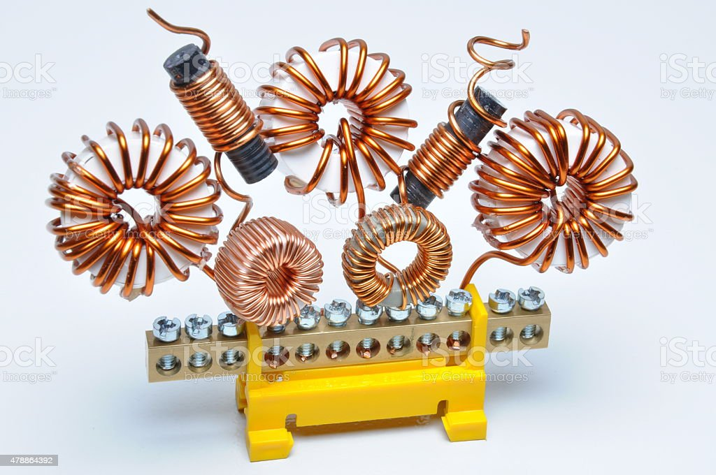 Copper coils and wires, abstract energy industry stock photo