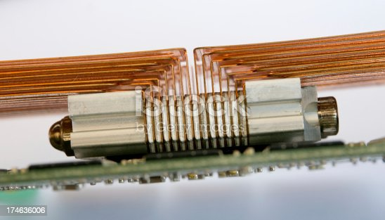 155152430istockphoto Copper cooler on circuit board 174636006