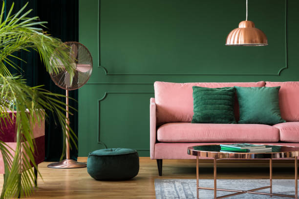 Copper lamp and table in a green living room interior. Real photo – zdjęcie