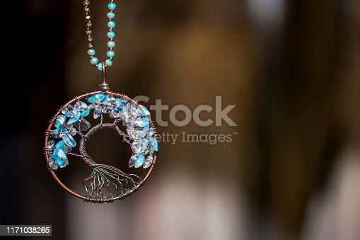 Copper Pendant necklace with Aquamarine Stones. Tree of life on dark background