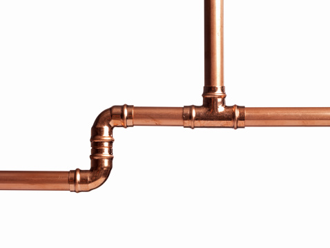 Soldered copper pipe isolated on white
