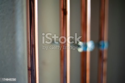 Installed copper pipes for heating system. Focus on first pipe. Converted from Nikon RAW.