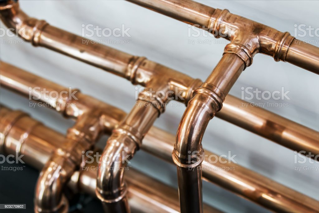 copper pipes and fittings for carrying stock photo