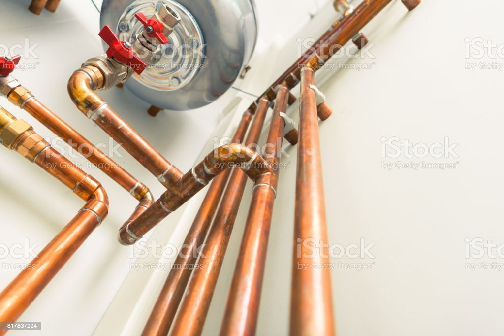 copper pipes engineering in boiler-room stock photo