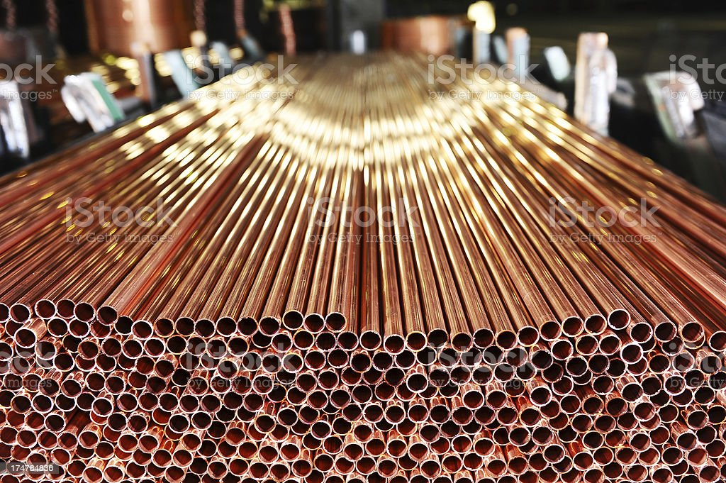 Copper pipes production stock photo