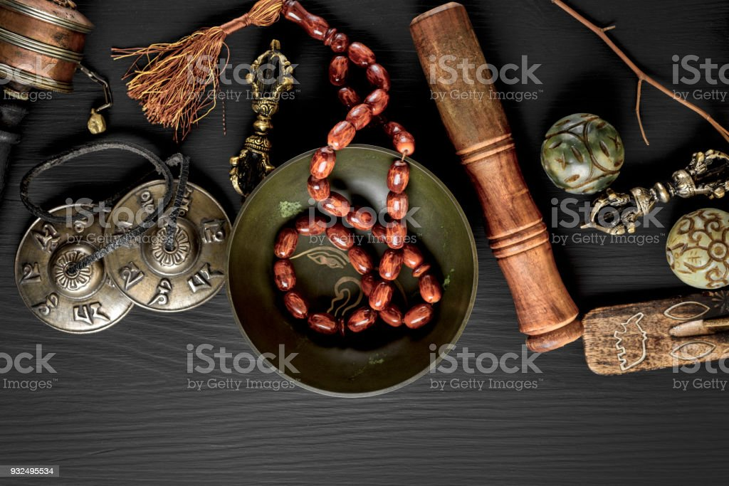 Copper singing bowl, prayer beads, prayer drum stock photo