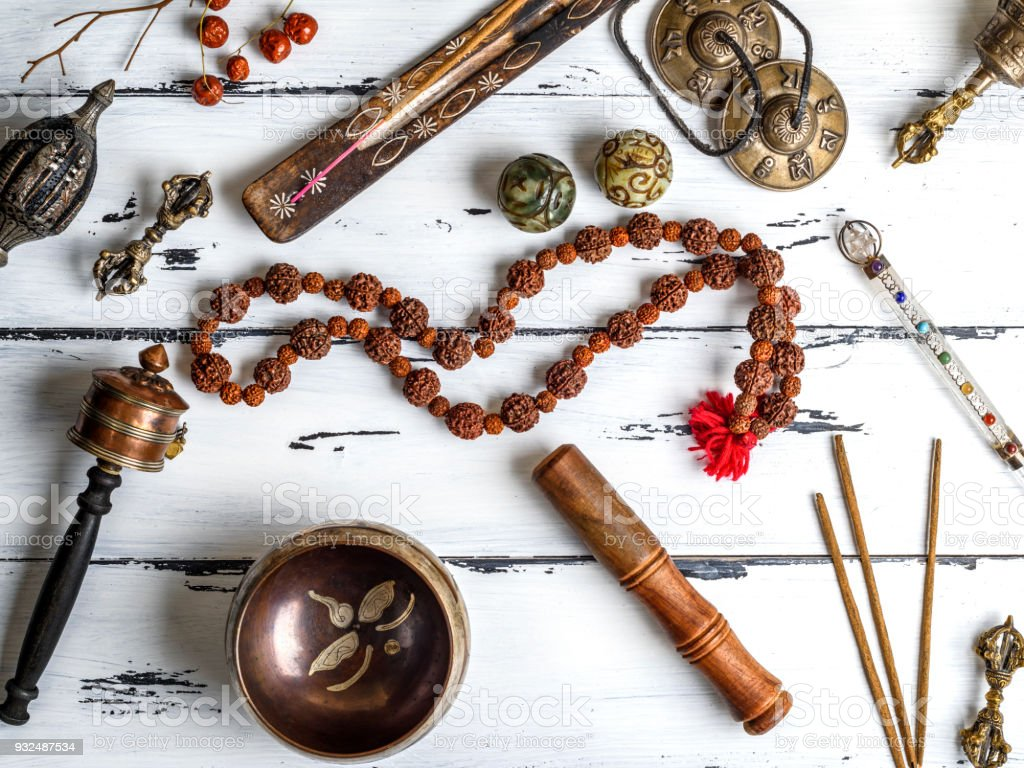 Copper singing bowl, prayer beads, prayer drum, stone balls stock photo