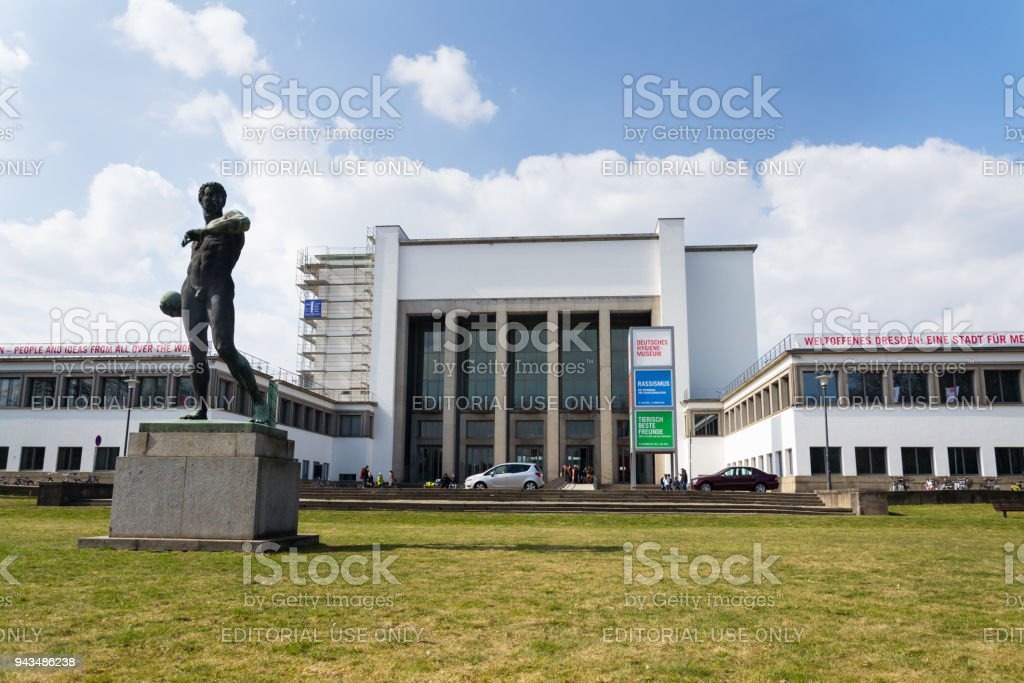 Copper Statue Ball Launcher by Richard Daniel Fabricius from 1907 in front of the German Hygiene Museum in Dresden, Germany stock photo