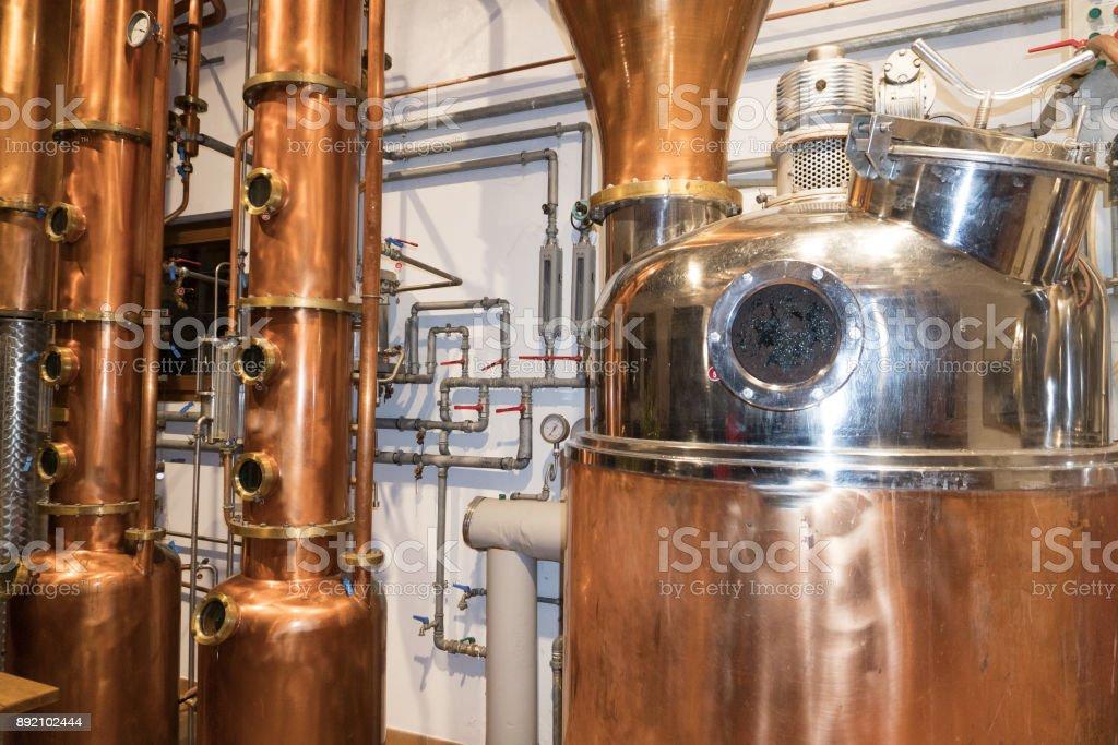 Copper still alembic inside distillery stock photo