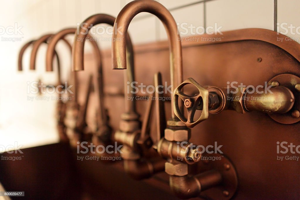 Copper taps stock photo