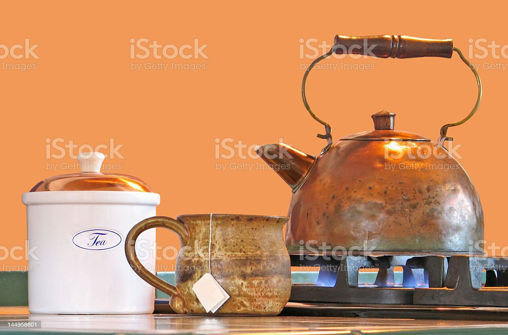 Copper tea kettle with mug and canister royalty-free stock photo