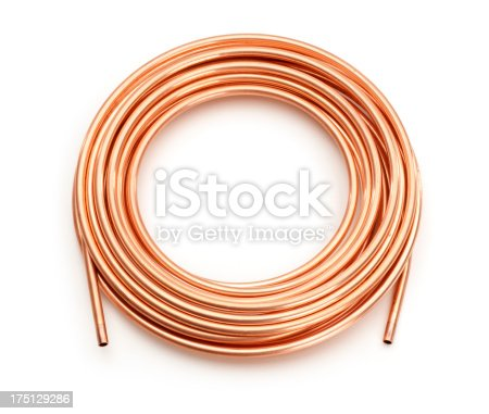 Coil of copper tubing pipe, isolated on white.