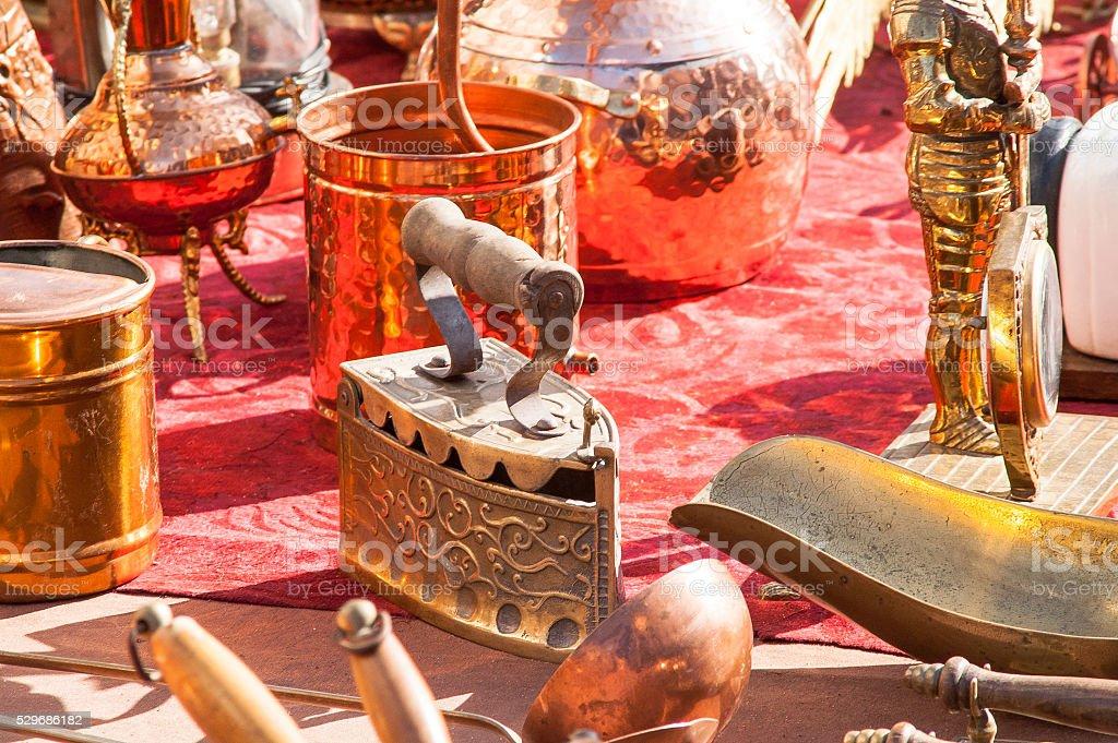 copper utensils flea market stock photo