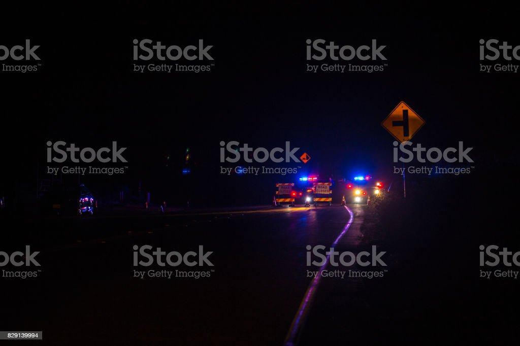 Cops at checkpoint during a wildfire stock photo
