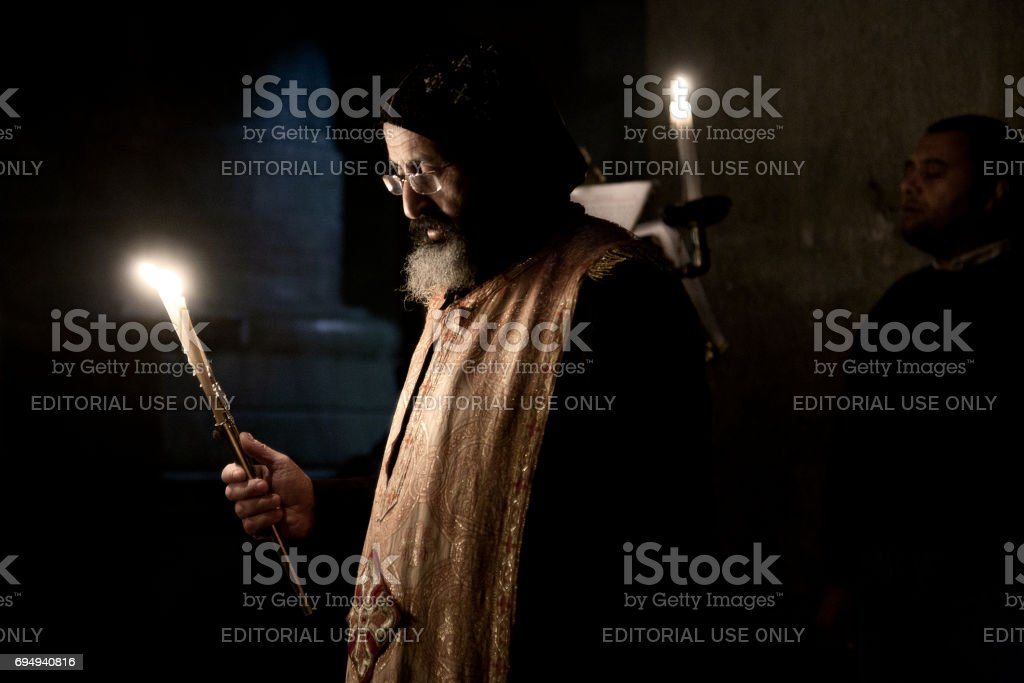 Coptic priest holds mass in Church of Holy Sepulchre stock photo