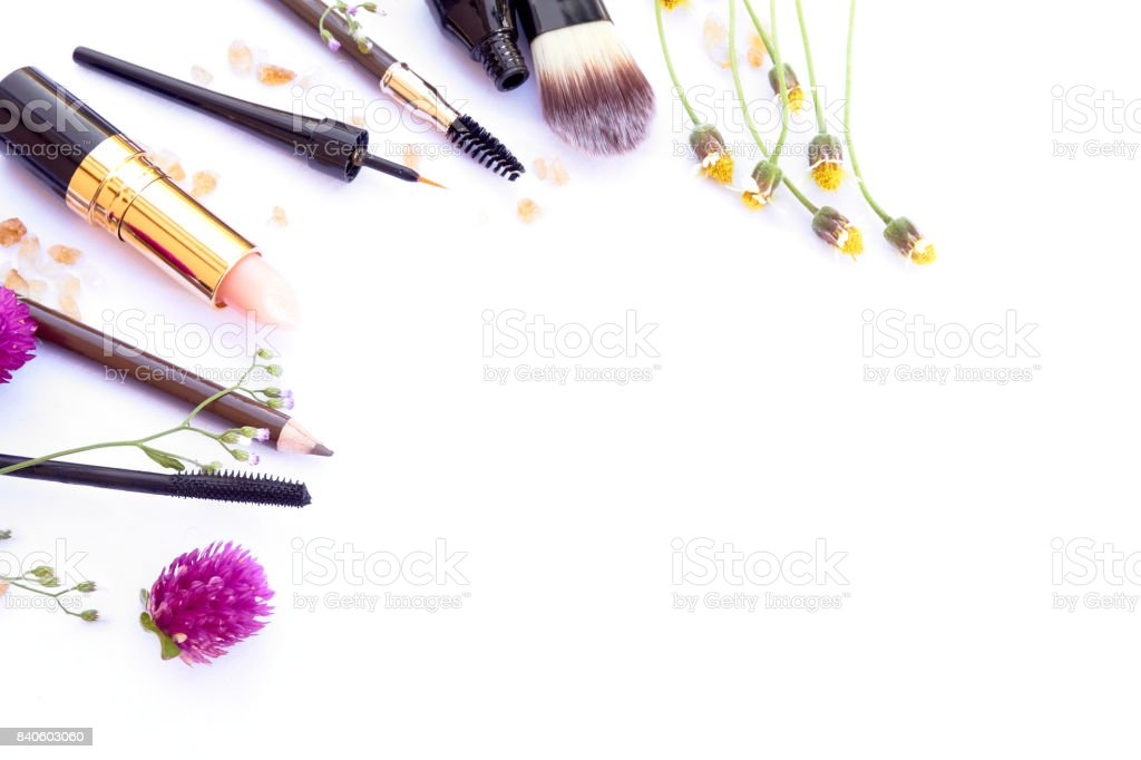 copy space Flat lay top view feminine table desk isolated on bright blue with cosmetics phone lipstick nail lacquer and brush stock photo
