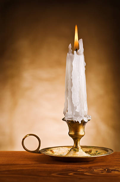 copy space image of ablaze candle in old candlestick copy space image of ablaze candle in old candlestick ablaze stock pictures, royalty-free photos & images