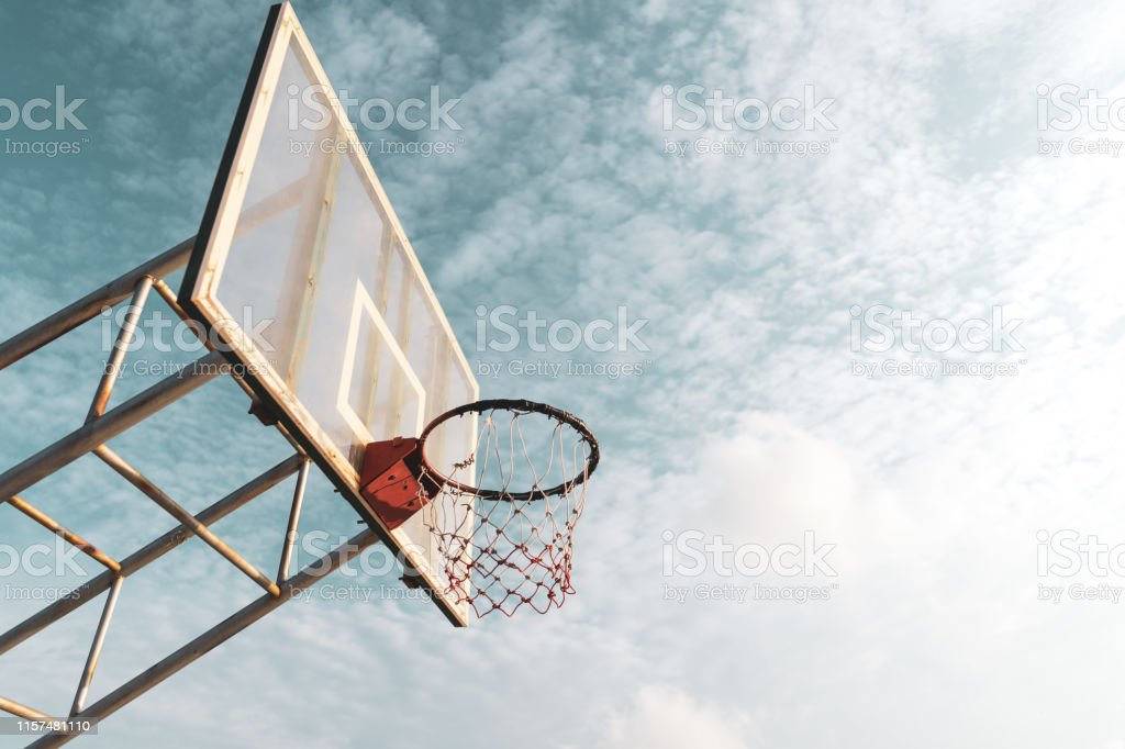 Copy space of outdoor basketball court on blue sky and white cloud...