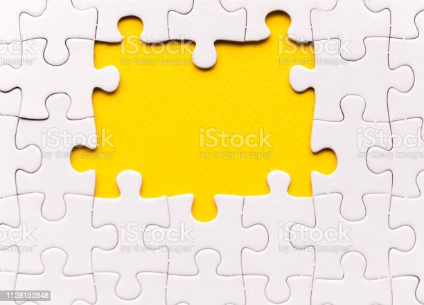 Copy space of unfinished white jigsaw puzzle pieces one missing on picture id1128152848?b=1&k=6&m=1128152848&s=612x612&h=zgpex5ul0q07td6ubd9zkkz4t69jbtntbf10iic5m s=