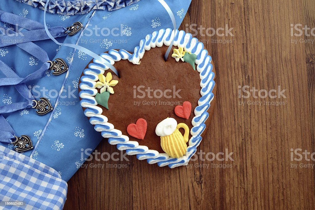 copy space Oktoberfest Dirndl with gingerbread heart royalty-free stock photo