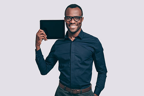 Copy space on his tablet. stock photo