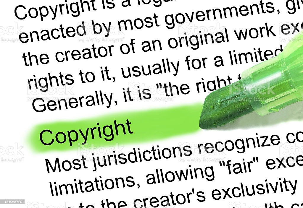 Copyright definition marked in dictionary stock photo