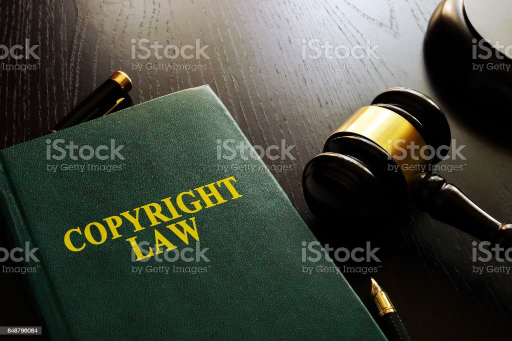 Copyright law and gavel on a table. stock photo