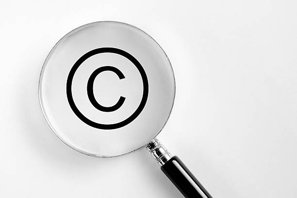 Copyright symbol in the microscope stock photo