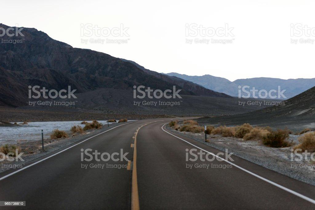 Copyspace / Background Single road going through the Desert - Royalty-free Asphalt Stock Photo
