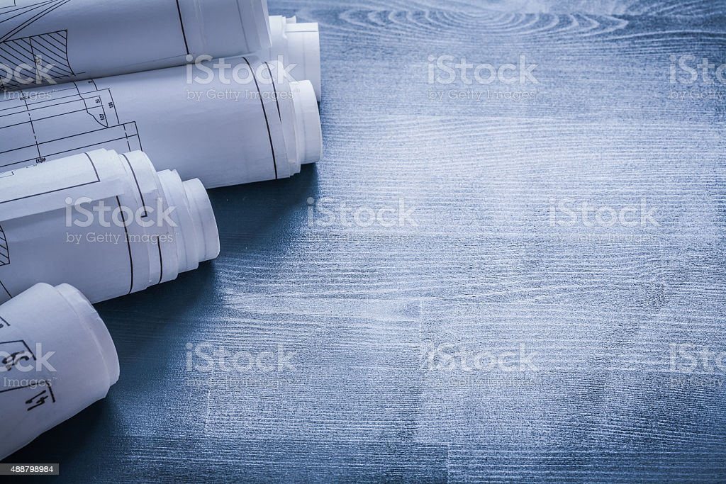 copyspace image five rolls of blueprints very close up stock photo