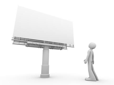 Man standing near copyspaced bigboard looking at it