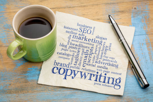 copywriting word cloud on napkin copywriting word cloud  - handwriting on a napkin with a cup of coffee copywriter stock pictures, royalty-free photos & images