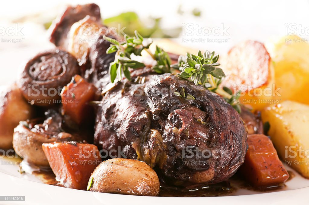 Coq au Vin dish with vegetables stock photo