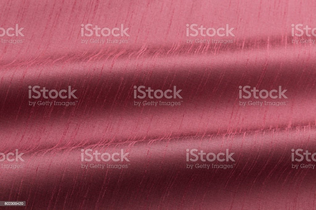 coral background luxury cloth or wavy folds of grunge silk texture satin velvet stock photo