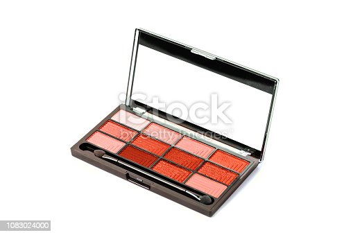 istock Coral colored Eye sfadows palette isolated on white. 1083024000