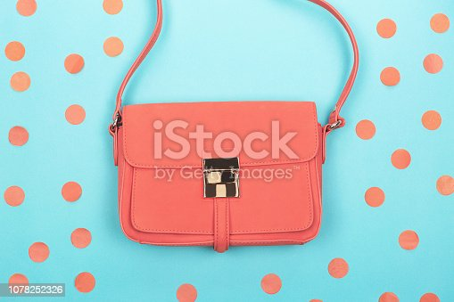 istock Coral fashion bag on contrast background 1078252326
