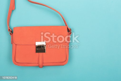 1078252566 istock photo Coral fashion bag on contrast background 1078252418