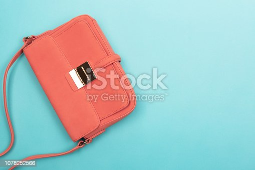 istock Coral fashion bag on contrast background 1078252566