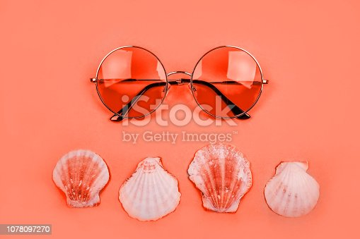 istock Coral flatlay with sunglasses 1078097270