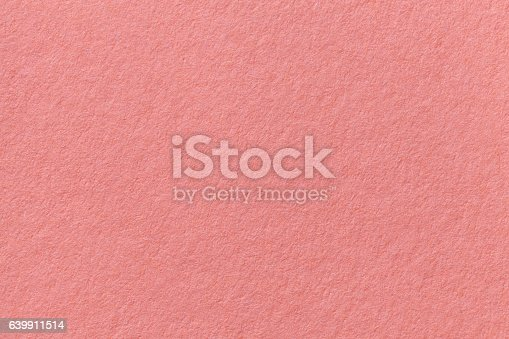 Pink old paper background. Thick cardboard. The texture of carton