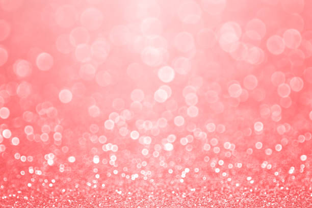 Coral Pink and Peach Glitter Sparkle Background Abstract elegant coral pink, peach and salmon color glitter sparkle confetti background or party invite for happy birthday, Christmas bokeh, mother's day, Spring, pale pastel easter flyer or wedding coral colored stock pictures, royalty-free photos & images