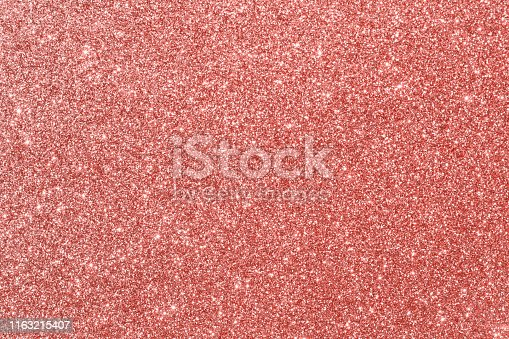 Coral pink red glitter background, sparkling shiny. Christmas holiday decoration