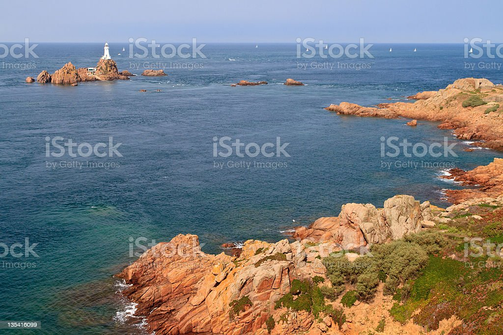 Corbiere Lighthouse and Rocky Coast, Jersey, The Channel Islands stock photo